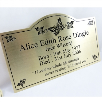 shaped brass plaque